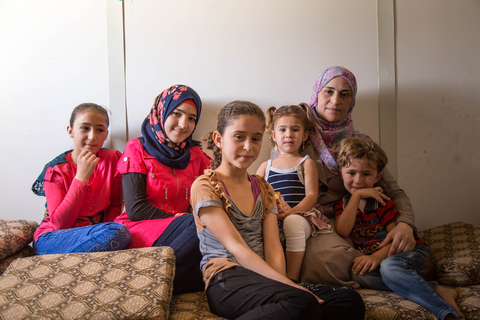 "Saba with her mother and siblings.  ""The family has a big role in the decision."" © UNFPA Jordan/Sima Diab"